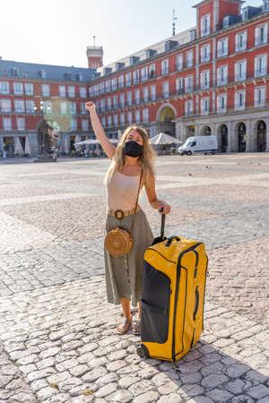 Happy Tourist in madrid, Spain Europe, traveling during post pandemic summer holidays. Woman wearing face mask taking selfie happy to be able to travel over the summer. Standard-Bild
