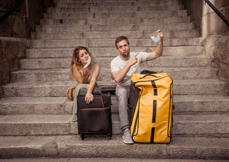 Unhappy tourist couple not able to travel abroad due to Post pandemic Travel restrictions. Family about to go on summer vacations tested positive for  virus  or flight was canceled.