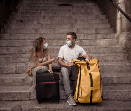 Unhappy tourist couple not able to travel abroad due to virus Travel restrictions.