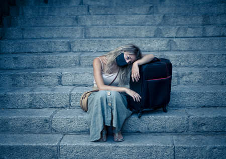 Summer Travel during virus and tourism. Sad Tourist woman with luggage and facemask could not get abroad over summer holidays. Standard-Bild