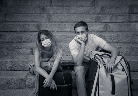Unhappy tourist couple not able to travel abroad due to Post virus Travel restrictions.