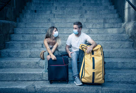 Unhappy tourist couple not able to travel abroad due to Post-virus Travel restrictions.