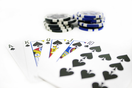 texas hold em: Playing Cards and Poker Chips Isolated on White Background