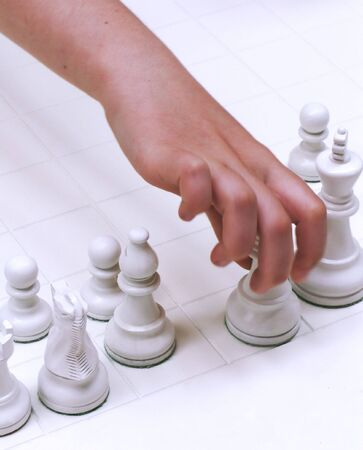 Hand in motion moving queen in chess game