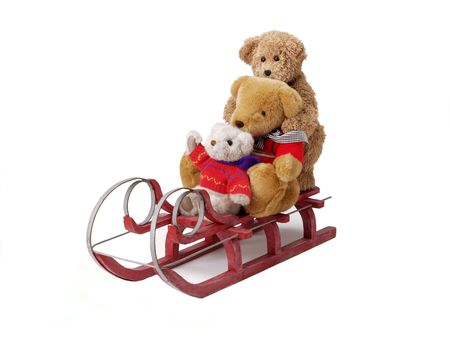 teddy bears on a red sleigh