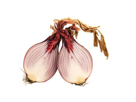 Red onion cut in half isolated on white