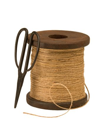 Wooden spool of garden twine and scissors Stock Photo