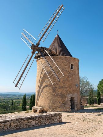 stone windmill in Provence, France    Stock Photo