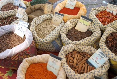 bags of spices on display in a market in Provence