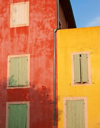 colorful walls of Roussillon in the warm setting sun of Provence