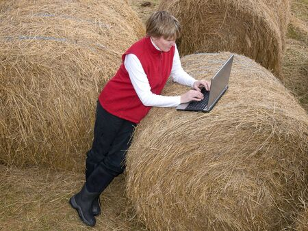 woman working wireless on laptop in the country