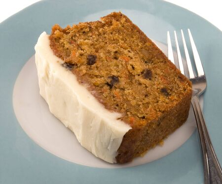 slice of carrot cake with cream cheese icing Stock Photo