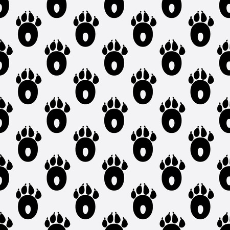 Seamless pattern with the prints of the dog s paws.