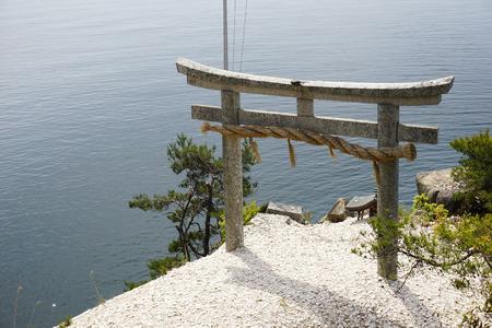 torii: Stone torii and lake Biwa