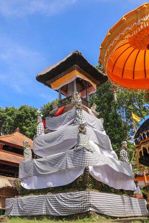 Balinese drum pavilion bale kulkul - bale kul-kul, for a slit-log drum, Bali, Indonesia. Bale kulkul at temple Pura Batukaru. Hindu religion, architecture and art. Vertical image.