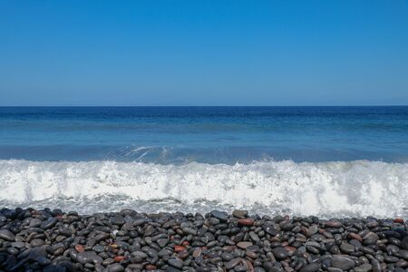 A small storm three or four points at sea, the wave hits the shore with a large pebble. Bali Sea, Indian ocean. Summer vacation vacation beach travel Stock fotó