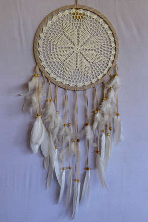 White color dream catcher with white feathers in the interior. Home Decor Concept..