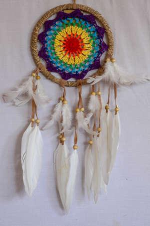 Beautiful multicolored handmade dreamcatcher on white background.