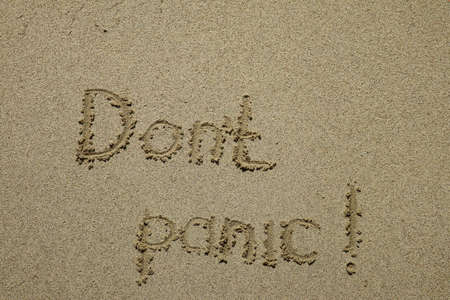 Dont panic concept written on the sand, stress