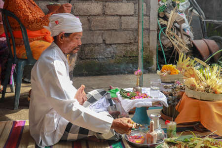 The Hindu Priest or widely known as Pedanda by the Balinese, blessing the ceremony of villas in Nuda dua,Bali