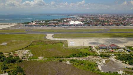 Airplanes at Balinese airport, Bali island, Indonesia. Aerial view to Ngurah Rai airport