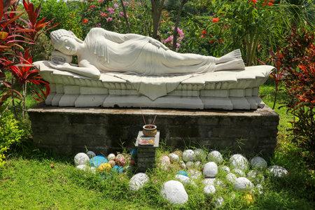 Statue of Sleeping Buddha at Vihara Dharma Giri, Buddhist temple in the village of Pupuan in Tabanan, West Bali, Indonesia.