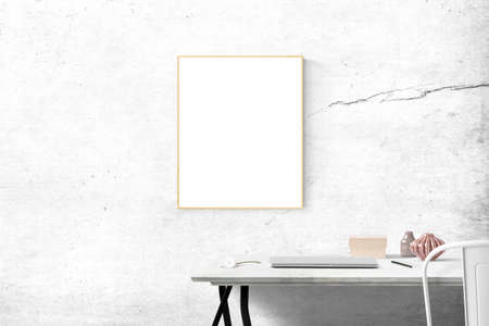 Blank framed print on white wall in beautiful danish styled interior room. Nicely decorated kids room in pastel colors, wooden toys, furniture and blank white poster on the wall Stock fotó