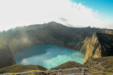 Volcanic lakes Ato Polo and Nuamuri koofai . National park Kelimutu. Kelimutu tri coloured volcano crater covered with mist an aerial view early morning, Indonesia