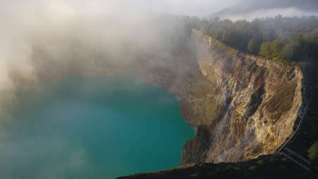 one of the turquoise green kelimutu lakes.. Kelimutu consists of 3 lakes that change color. Sometimes, are blue, green, and black, and some other times they turn to white, red, and blue