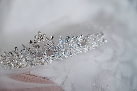 Beautiful brides crown is on the veil, close-up. Wedding day. Morning bride. Banco de Imagens