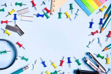 School and office supplies on the freelancers desktop. Top view with copy space. Frame with stylish stationery. The concept of school and preschool education, office work.