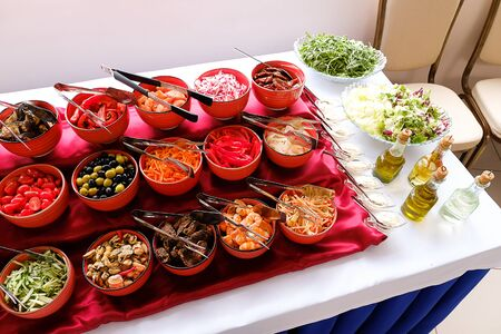 Bowls of salads on the buffet table at the Banquet. Stok Fotoğraf - 133141779