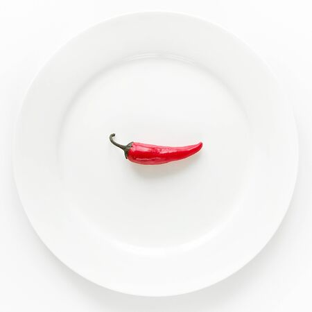 Red hot chili pepper on white plate on white background. Stok Fotoğraf - 133141812