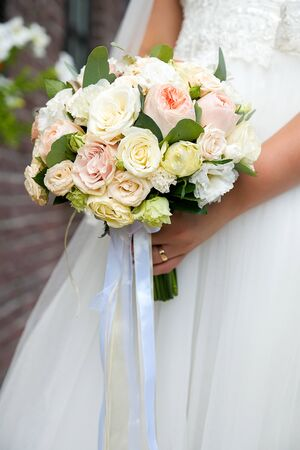 Bouquet with pink and white flowers in the hands of the bride. Stok Fotoğraf