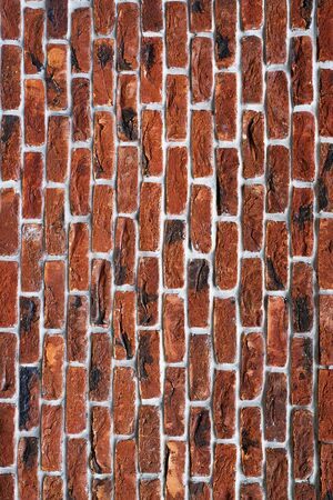 Red brick wall with toning. The facade of the building with new plaster. Abstract banner. Brickwork. Background. Texture.