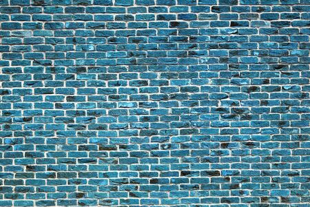 Blue or turquoise brick wall with toning. The facade of the building with new plaster. Abstract banner. Brickwork. Background. Texture. Stok Fotoğraf - 132719955