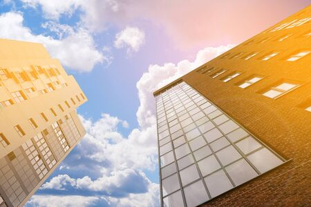 Modern multi-storey brick buildings with stained glass balconies against the sky. Stok Fotoğraf - 133077181