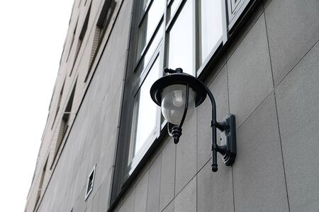 Street lighting on the facade of the building.