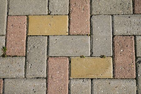 Colored and gray cobblestones, cobbled sidewalk, stone path. Stok Fotoğraf - 134740767