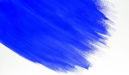 Abstract Background with Streaks of Blue Paint or Watercolor on a White Sheet. Copy Space For Text.