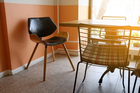 Interior Of A Cafe Or Fast Food Restaurant. An Old Wooden Table And Chairs, Next To The Window. Stok Fotoğraf