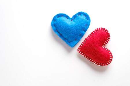 Red And Blue Hearts Or Valentines On A White Background. The concept of handmade for Valentines Day. symbol of love. Copy Space.