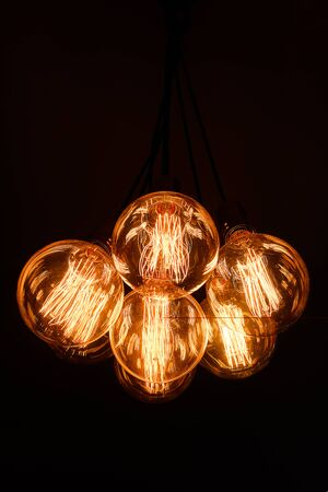 Glass Retro Edison Lamps On A Dark Background. Designer Light And Lighting In Interiors.