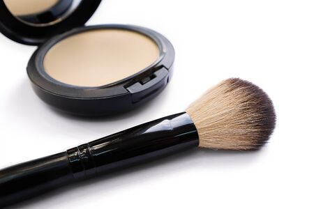 Mineral Compact Powder with a Brush for Application, isolated on a white background. Stok Fotoğraf