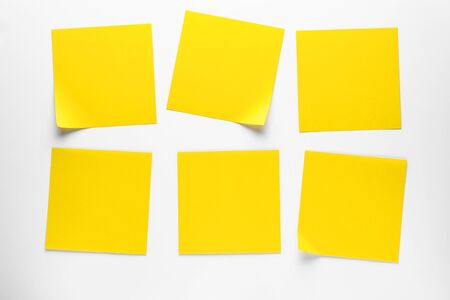 Yellow Sticky Stickers On A White Background To Remind You Of Information. Space For Text.