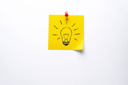 Creative drawing of a light Bulb On a Yellow Sticker. The concept of New Ideas, Innovations, solutions to problems. Stok Fotoğraf