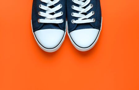 New Clean Blue Sports Sneakers With White Laces, On A Fashionable Background Of Lush Lava.