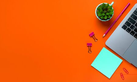Laptop, Flower, stickers, paper Clips, Stationery On a background of lush lava. Workplace Freelancer, Businessman, Entrepreneur, Business Woman. Banner. Stok Fotoğraf