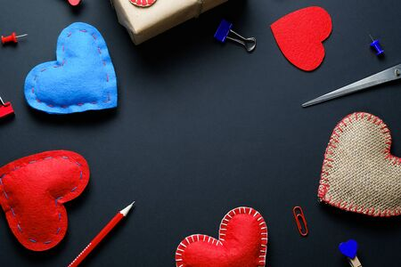 The background of Valentines day. Red And Blue Paper Clips, Clothespins, Gifts, Valentines, Ribbons, Pencils. The concept of handmade. Flat Layout, Space For Text. Stok Fotoğraf