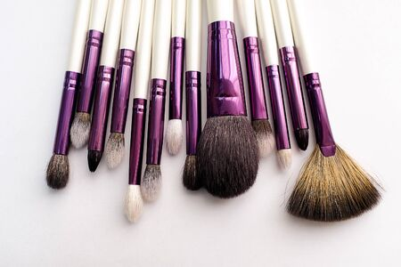 Set Of Makeup Artist Brushes For Professional Makeup In A Beauty Salon, On A White Background. The Concept Of Cosmetics, Body And Face Care.